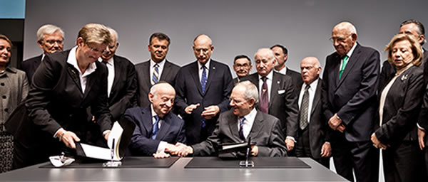 German Minister of Finance Wolfgang Schäuble, right, hosted a ceremony marking the 60th anniversary of the first compensation agreements with the Claims Conference in Berlin.
