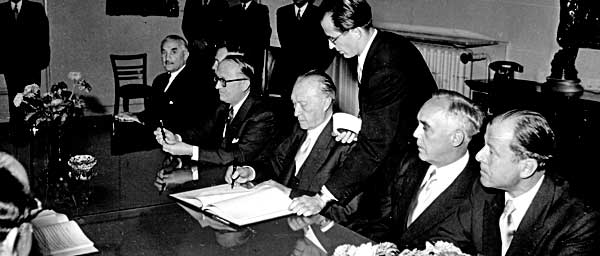 German Chancellor Konrad Adenauer signing the Luxembourg Agreements on September 10, 1952.