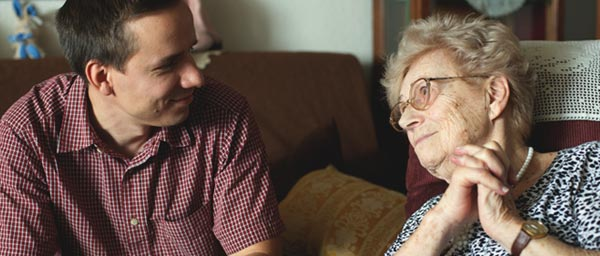 Agnes, a Holocaust survivor in Hungary with her social worker