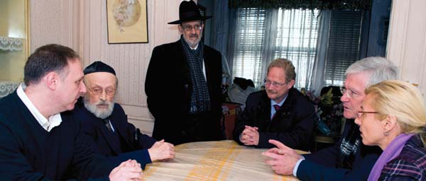 Claims Conference Executive Vice President Greg Schneider, left, took German officials to visit Holocaust victims before negotiations.
