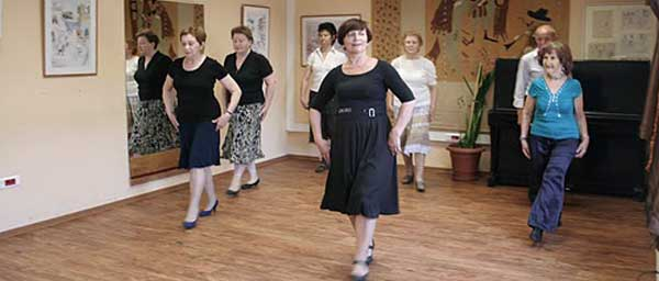 Nazi victims enjoy a dance class at a local Hesed.