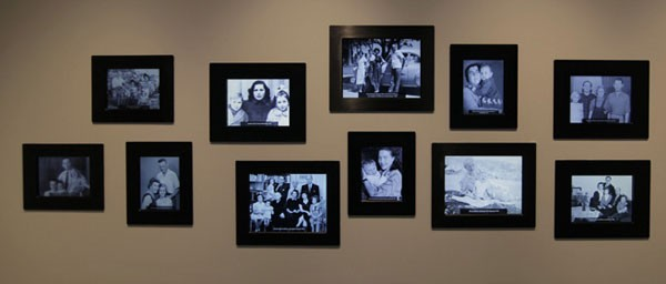 "The ""Return to Life"" gallery shows interchanging photographs of Holocaust survivors with their families."