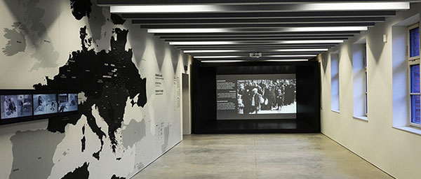 """The """"Shoah"""" exhibition starts with a cinematic montage of Jewish life between the world wars, followed by a display on Nazi racist ideology. In the space depicting the attempted annihilation of the Jewish people, a map illustrates the vast geographic reach of all Nazi-era killing sites."""