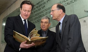 Henry Foner, right, was at Yad Vashem when Avner Shalev presented the book to PM Cameron as a memento of the role his country played in saving 10,000 Jewish children from the Nazis. The Claims Conference helped fund publication of an English/Hebrew version of the book.