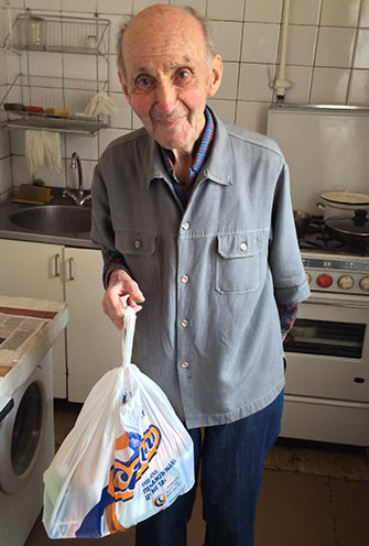 Mihail, a Holocaust victim in Kiev who receives aid funded by the Claims Conference, was grateful and relieved to receive food brought to him by the American Jewish Joint Distribution Committee (JDC), which works with the local Hesed social service agency.