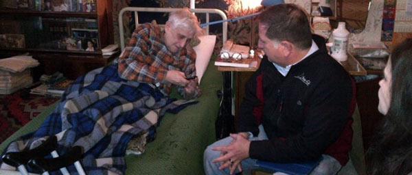 JDC staff member visits with an elderly Nazi victim in Ukraine.