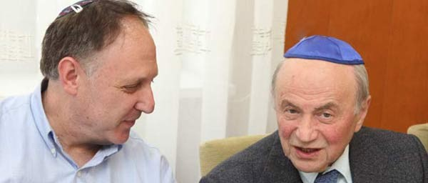 Claims Conference Executive Vice President Greg Schneider with Liviu Beris, President of the Association of Romanian Jewish victims of the Holocaust.