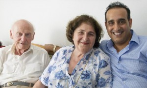 Eran-Shoham Simchi, right, of the Jewish Welfare Organization in Zurich visits with survivors Katharina and Erwin Hardy. Katharina receives an Article 2 pension as well as homecare and dental care. On the day of the visit, her husband Erwin received news that he was approved for an Article 2 pension as well.