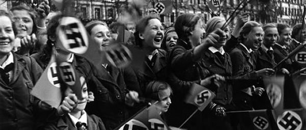 Austrians welcoming the Nazis after the Anschluss. For decades, Austria regarded itself as the first victim of Nazism.