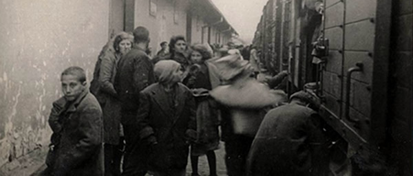 Skopje, Yugoslavia, Jews about to board a deportation train next to the Monopol tobacco depot, March 1943. Photo: Yad Vashem